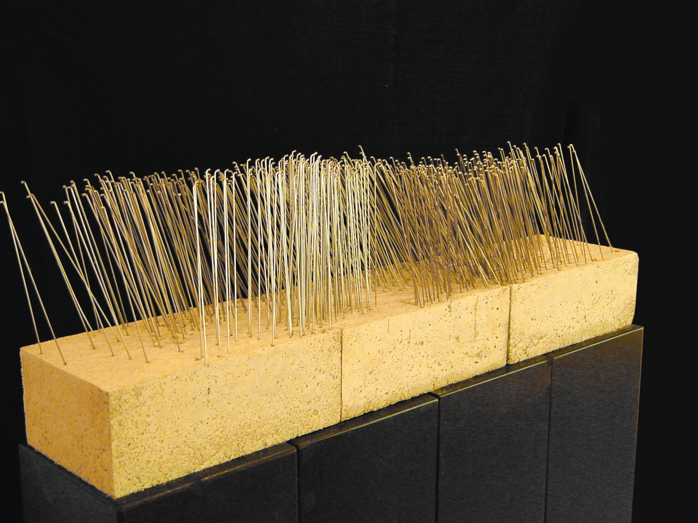 """Upheaval"", spokes, concrete, 120 x 50 x 30 cm, 2002"